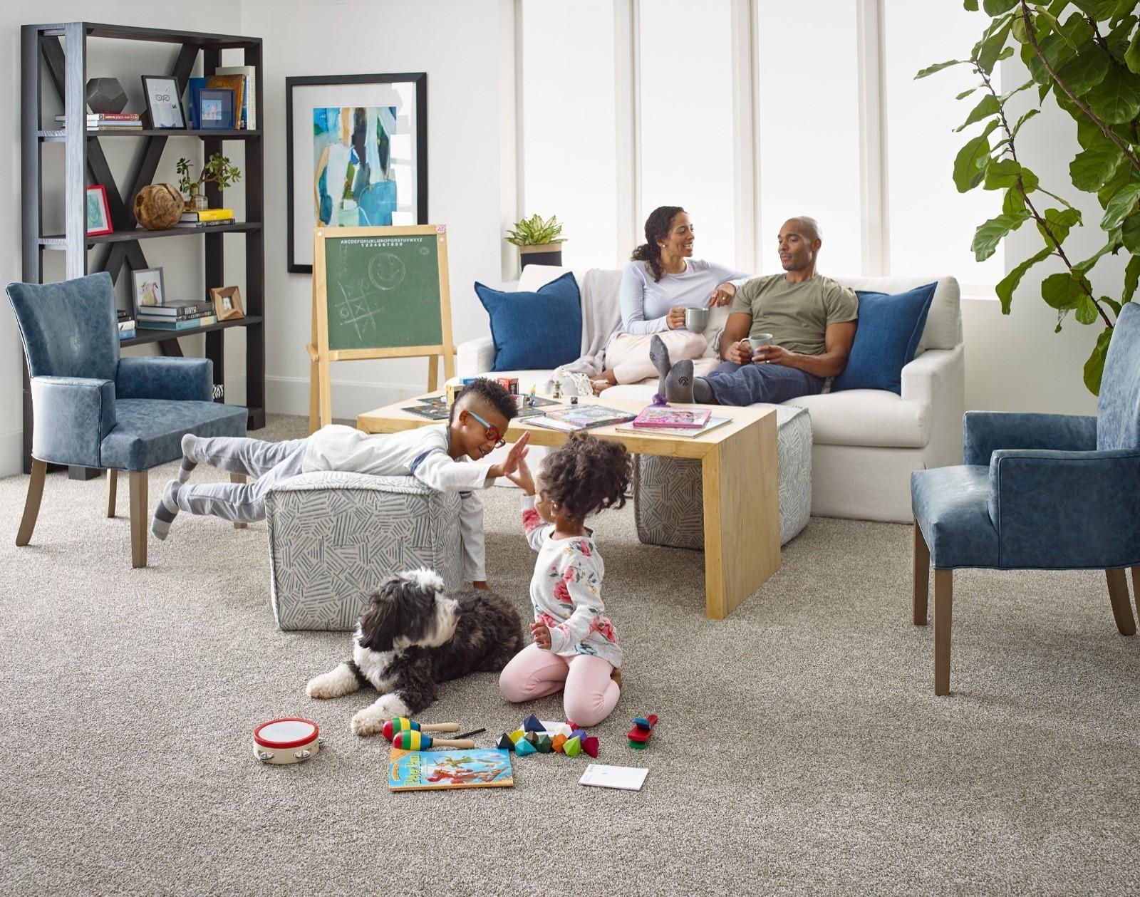 Family enjoying on grey carpet | O'Krent Floors